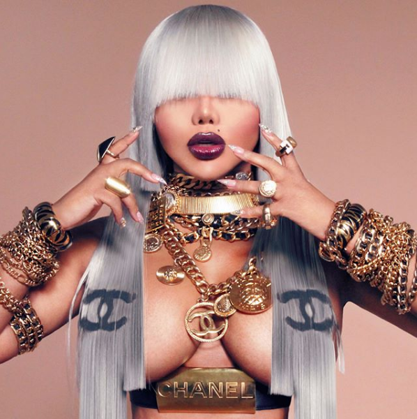 Lil Kim Stuns In MCM, Poses Topless In New Chanel Designed Hair